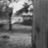 Walking along a House, 1972, photograph
